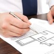 Architect draws a drawing house project — Stock Photo #39693245