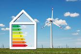 Haus mit dem schild vor dem hintergrund der energieeinsparung feld wi家の省エネの背景上の記号をフィールドの wi — Stockfoto
