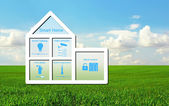 House with a smart home system on a background of green grass an — Stock Photo