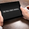 Businessman holding ipad with Wall Street Journal on the screen — Stock Photo #44533077