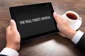 Businessman holding ipad with Wall Street Journal on the screen — Stock Photo
