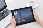 Female hands holding iPad with app Flipboard on the screen in th — Stock Photo