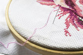 Pink embroidery on hoop — Stock Photo