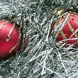 Red balls in tinsel — Stock Photo