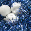 Three balls on tinsel — Stock Photo