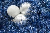 Three balls on tinsel — Stock Photo