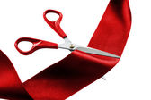 Cutting red ribbon — Stock Photo