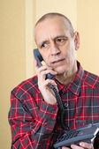Preoccupied Man on Phone — Stock Photo
