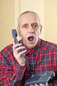 Man Surprised on Phone — Photo