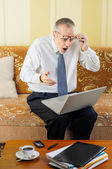 Surprised Senior Businessman with Computer — Stock Photo