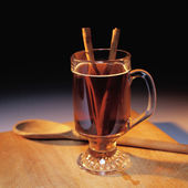 Tasty drink with a stick of cinnamon — Stock Photo