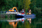 Yellow Excavator and barge — Foto de Stock