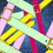 Seamless pattern with colorful belts on the jeans background, eps10 — Векторная иллюстрация