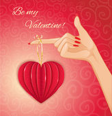 Woman hand with decorative paper red heart for Valentines Day, eps10 — Stok Vektör