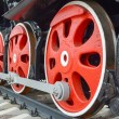 Постер, плакат: Red wheels of old locomotive