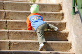 Child climbs up the stairs — Stock Photo