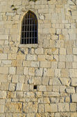 Window in the wall of the old tower — Stock Photo