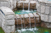 Water flowing down the stone steps — Stock Photo