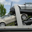 Stock Photo: Cars on transporter