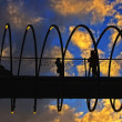 Stock Photo: Slinky bridge at sunset