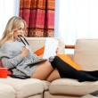 Attractive woman with laptop in home — ストック写真 #19676749