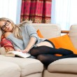 Stock Photo: Womnapping on her sofa