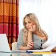 Attractive woman writing on laptop — Stock Photo #19678031