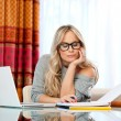 Attractive womwriting on laptop — Stock Photo #19678045