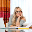 Stock Photo: Attractive womwriting on laptop