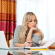 Attractive woman writing on laptop — Foto de Stock