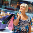Woman in shopping mall — Stock Photo #19679703