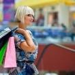 Woman in shopping mall — Stock Photo #19679819