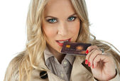 Woman with credit card — Stock Photo