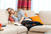 Woman napping on her sofa — Stock Photo