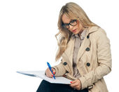 Woman writing in the notebook — Stock Photo