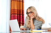 Attractive adult woman with laptop — Stock Photo