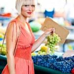 Woman on market place — Stock Photo #19680443