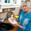 Woman washing dishes — Stock Photo #19680973