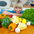 Woman in kitchen with vegetables — Stock Photo #19681035
