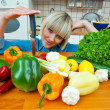 Woman in kitchen with vegetables — Stock Photo #19681043