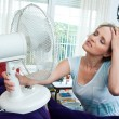 Woman cooling herself — Stock Photo