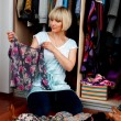 Woman choosing clothes — Stock Photo #19681539
