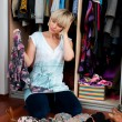 Woman choosing clothes — Stock Photo #19681757