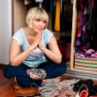 Woman in front of full closet — Stock Photo #19681797