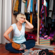 Stock Photo: Womin front of full closet