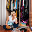 Woman in front of full closet — Stock Photo #19682133
