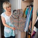 Woman choosing clothes — Stock Photo #19682521