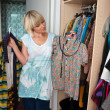 Foto de Stock  : Woman choosing clothes