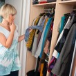 Woman choosing clothes — Stockfoto #19682637