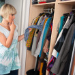 图库照片: Woman choosing clothes